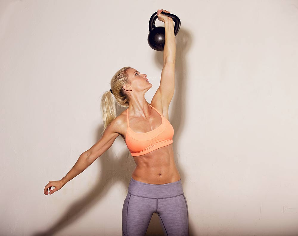 Woman doing her kettlebell crossfit workout